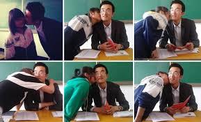 Hot teacher kissing student in classroom