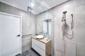 frameless shower screen with polished silver hinges clips with a glass header