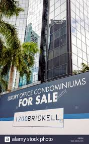 luxury office space. Miami Florida Brickell Avenue Office Space Building Luxury Condo Condominium Sign Glass Windows Palm Tree Reflection For