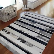 shades of grey rugs the rug establishment grey can also work to the opposite effect by being a remedy to deacutecor mistakes for example if you bought a bright yellow arm chair and think it s too loud