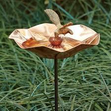 copper bird bath on garden stake