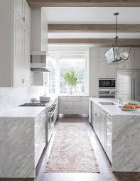 white kitchen with grey and white quartzite waterfall edge countertops view full size
