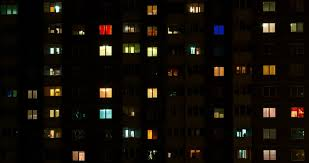 light in the windows of a multistory building time lapse 4k stock clip