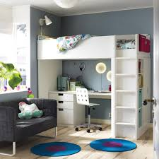 a room with a white loft bed combination that includes a desk chest of drawers