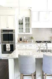 white kitchen cabinets with granite countertops kitchen island white shaker cabinets and soft grey subway tile