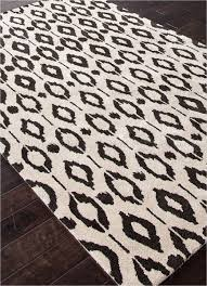 jaipur foundations chayse ikat dot hand tufted geometric pattern wool art silk ivory black area rug