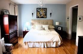 gray bedroom with blue accent wall. blue accent wall bedroom and brown divider gray with