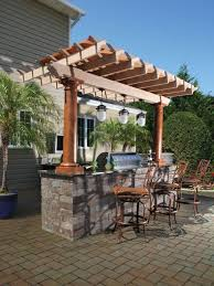 pergola kitchen. herringbone patterned pavers with simple pergolar using one line outdoor kitchen designs for adorable backyard ideas pergola