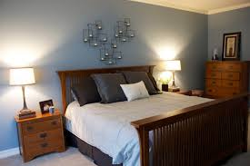 soft gray blue in the master bedroom with wood furniture