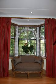 decoration bay window design ideas white wall paint red curtain glass window panel with muntins