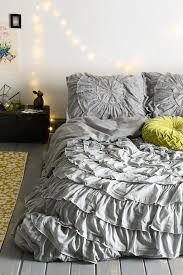Urban outfitters Bow Ruffle-Medallion Duvet Cover- not sure what my  obsession with ruffled bedding is lately but I love this - Interior Ideas