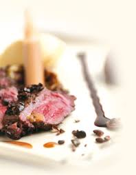 chocolate sauce with game serve with a fillet of vension sprinkled with callebaut cocoa nibs