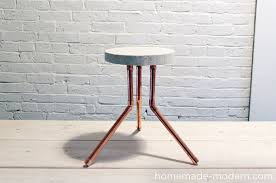 View in gallery Stool made from concrete and piping