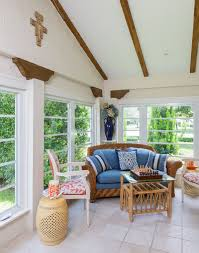 ... Original wooden beams of the house and custom decor steal the show in  the small sunroom