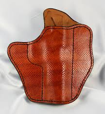 this illusion holster is full coverage rust colored sea snake it is for a commander