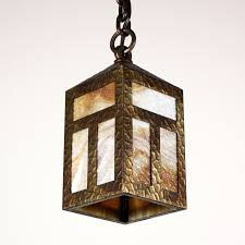 delightful antique exterior arts crafts lantern with original slag granite glass dating from the early 1900s this hammered brass lantern begins in an