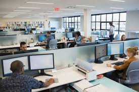 images of an office. A View Of An Office With Employees Sitting At Their Desk Images ABC
