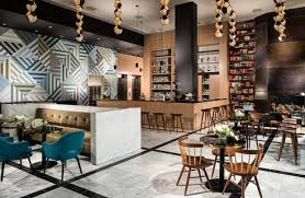 with interiors and public spaces curated by commune design theyve created the lobby as a club like central gathering space with a coffee bar and a california interiors commune designs