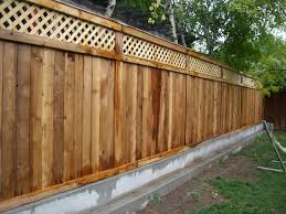 exterior: Attractive Wooden Fence Which Is Decorated Using Unique Fence  Ideas Covering Spacious Backyard That