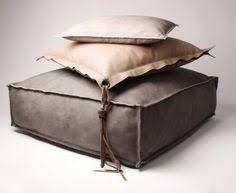 JORIS, Italian leather poof and pillows