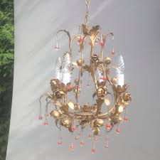 beautiful romantic chandelier in gold plated metal and coloured glass drops