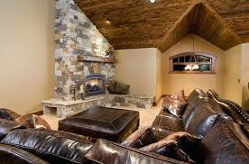 vaulted ceiling fireplace lighting a space with