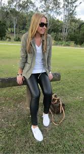 picture of leather leggings a khaki field jacket and white sneakers for a casual look
