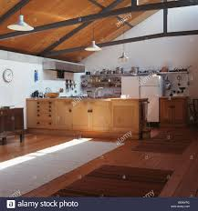 Kitchen Floor Units Pale Wood Fitted Units In Large Modern Barn Conversion Kitchen