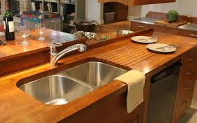teak wood countertop with sloping drainboard