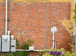 brick wall with electrical meters