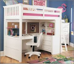 girls white wooden bunk beds with desks and chair