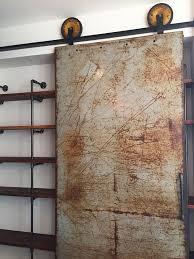 steel sliding garage doors. Metal Sliding Barn Door With Vintage Lawnmower Wheels Steel Garage Doors I