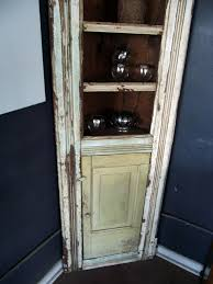 this is a very old amazing piece aged naturally this corner cabinet has tones of green pale green yellow cream white etc there are four shelves and