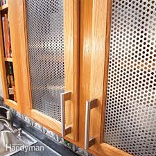 Diy glass cabinet doors Kitchen Cabinets View In Gallery Perforated Steel Kitchen Cabinet Inserts Decoist Lowcost Diy Ways To Give Your Kitchen Cabinets Makeover