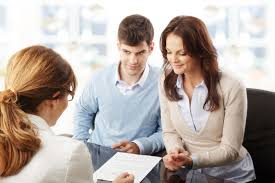 be prepared for your mortgage pre approval interview by having young couple discussing financial plan consultat