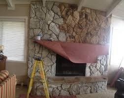change your old 70 s fireplace with paint keep the rock look painted fireplacesstone fireplacespainted stone fireplacewhite wash fireplacefaux