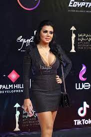 صور .. رانيا يوسف تواصل إثارة الجدل .. شاهد إطلالاتها فى عرض فيلم بيك نعيش