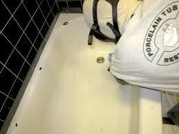 tech repairing tub damage