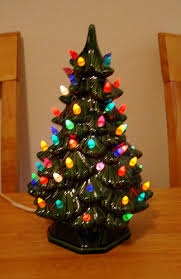 Light-up ceramic Christmas tree. These go great in the middle of a little  Christmas town---like a town tree!