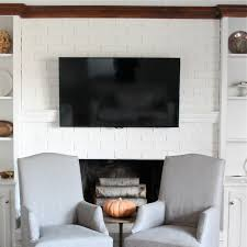 easy inexpensive diy mantel to conceal tv and cable cords via julieblanner