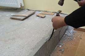 removing wall tile adhesive