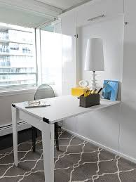 hideaway office design. foldable office desk in minimalist white interior design hideaway