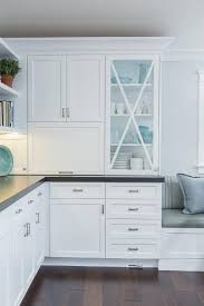 glass front kitchen cabinets with x trim moldings