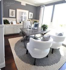 home office white. i would rearrange this as a home office and use the two white chairs