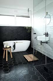 hexagon bathroom tile black hexagon tiles on the floors and walls for a masculine bathroom hexagonal
