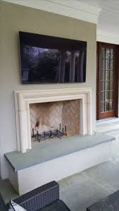 modern cast stone or concrete fireplace surround
