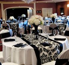 Dramatic black and white wedding reception. I like the table runner idea!
