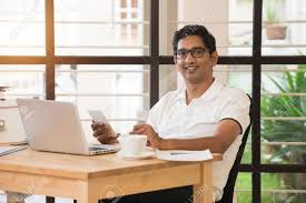 working for home office. Stock Photo - Young Indian Man Working From Home Office For F