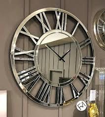 large mirrored wall clock