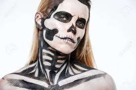 closeup of woman with skeleton makeup over white background stock photo 63163646